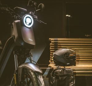 A NIU UQi GT with a helmet on a bench