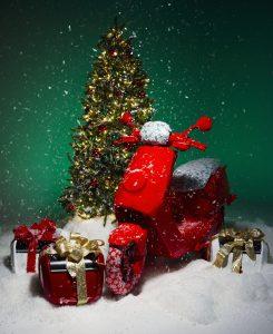 A NIU NQi GT wrapped next to a Christmas tree