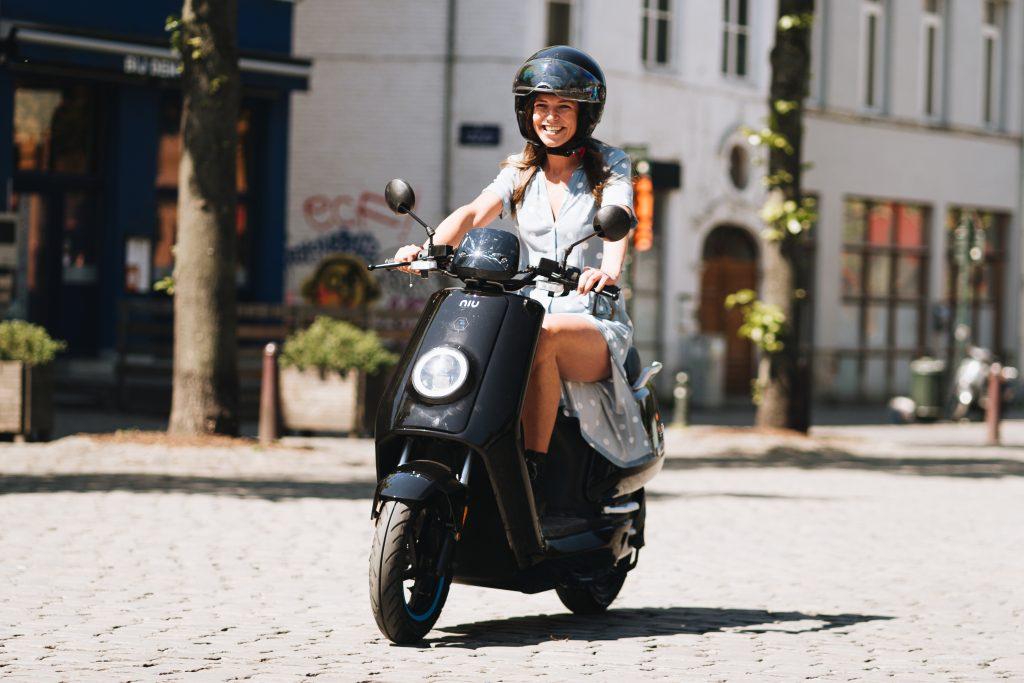 A woman enjoying her NIU scooter commute