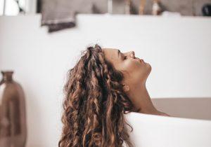 Woman relaxes in a bathrub