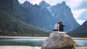 A couple enjoying the view on a lakeside hike