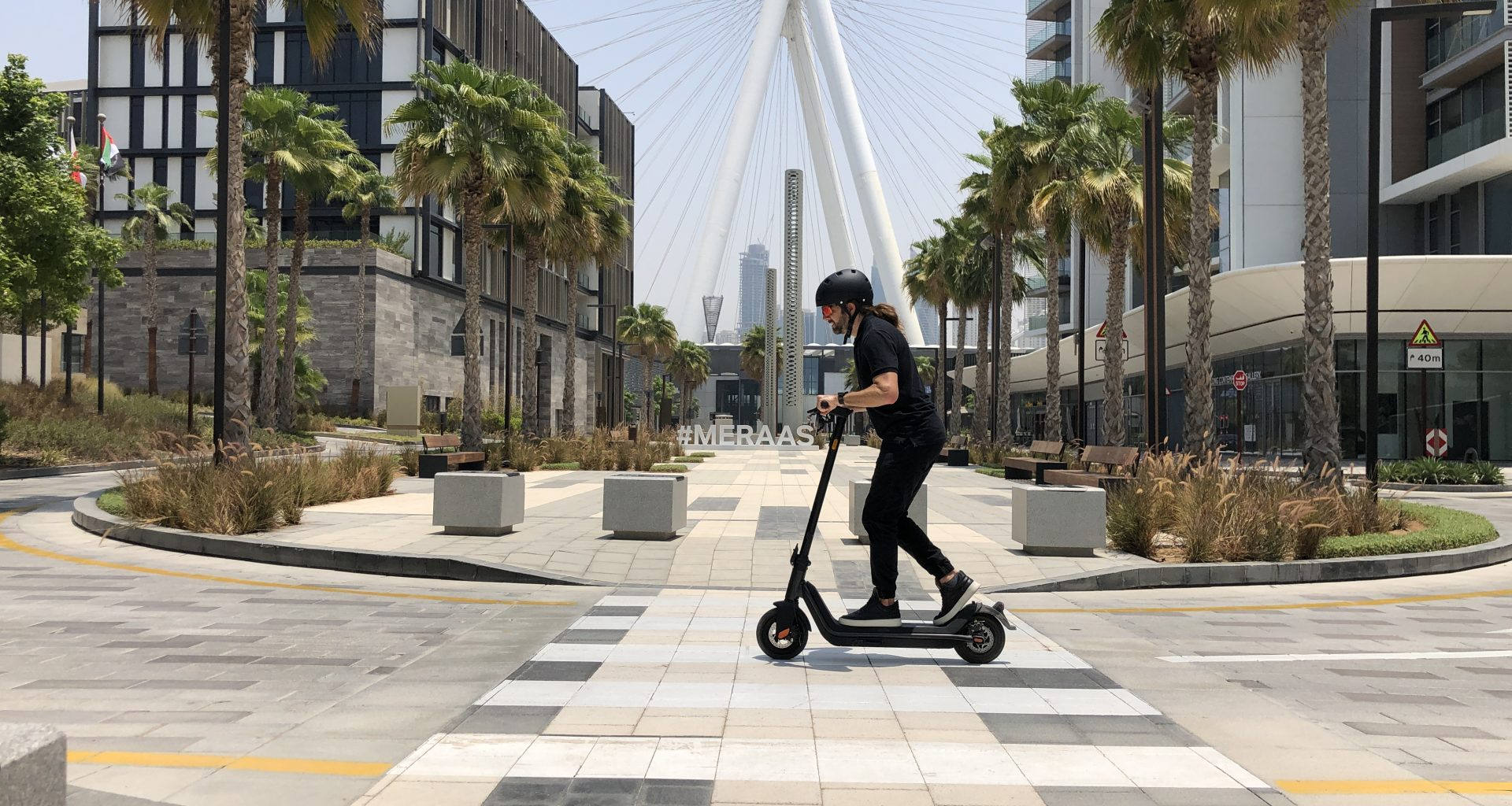 An electric scooter commuter riding a NIU KQi3