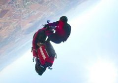 JT Holmes skydives with a NIU scooter